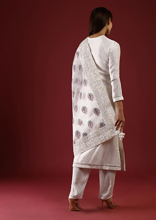 Daisy White Straight Cut Suit With Mirror Work On The Yoke And An Organza Dupatta With Multi Colored Thread Embroidered Floral Buttis Online - Kalki Fashion