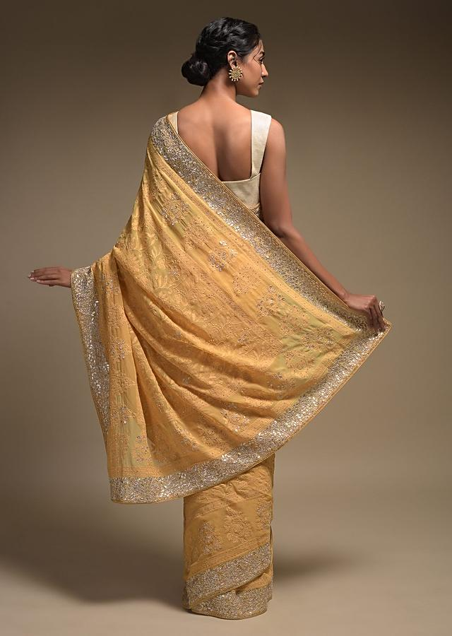 Dandelion Yellow Saree In Georgette Adorned With Lucknowi Thread Embroidery In Floral Jaal Online - Kalki Fashion