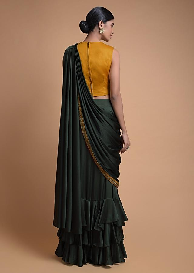 Dark Olive Green Skirt In Satin With Layered Ruffle Frill And Embellished Yellow Blouse Online - Kalki Fashion