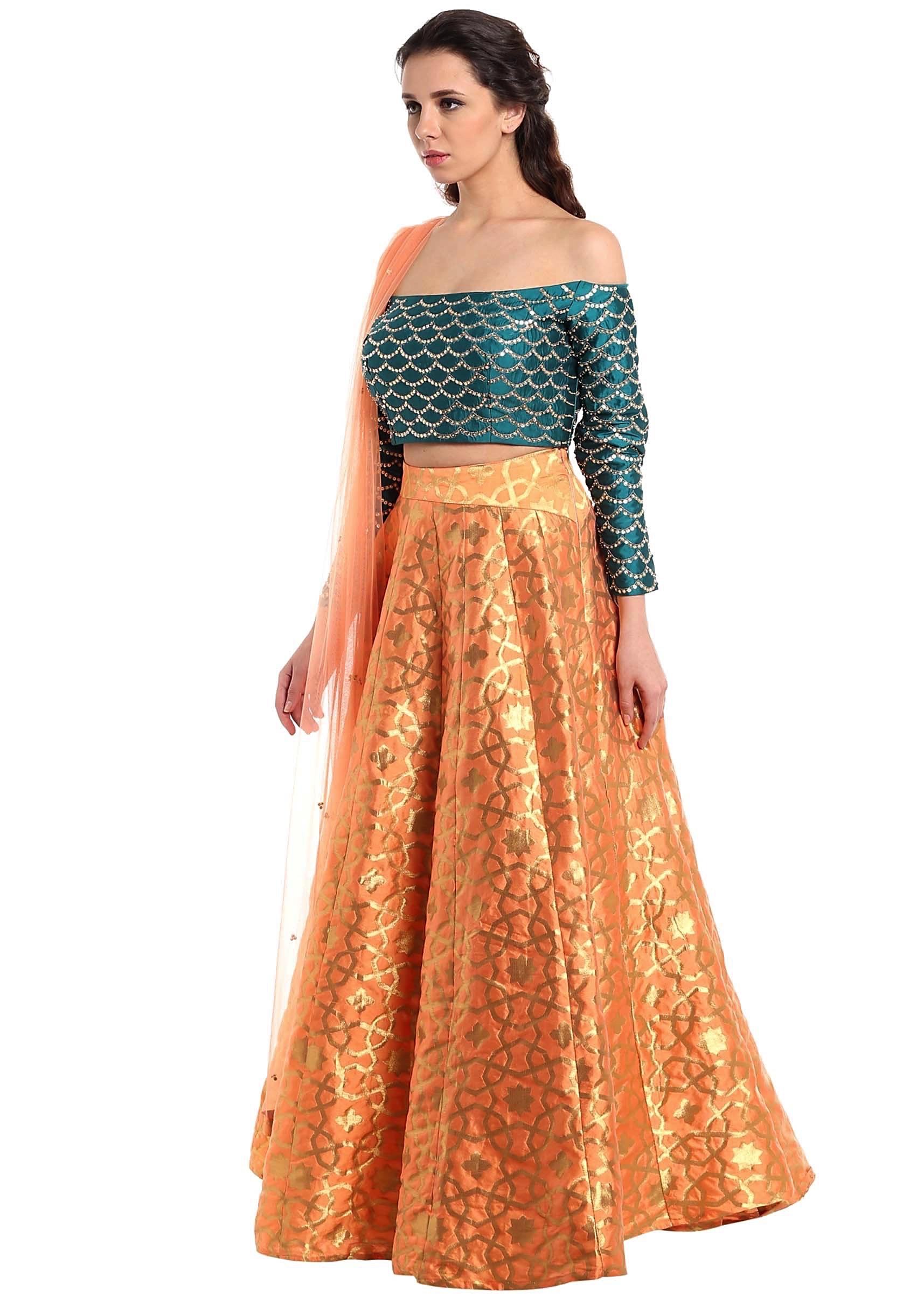 cf7d7c2bc07e3c Dark peach lehenga with off shoulder teal blouse only on Kalki