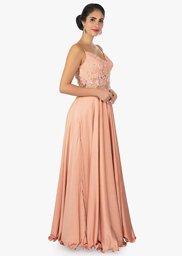 Dark Peach Gown In Satin With Spaghetti Strap And Sheer Waistline And Back Online - Kalki Fashion