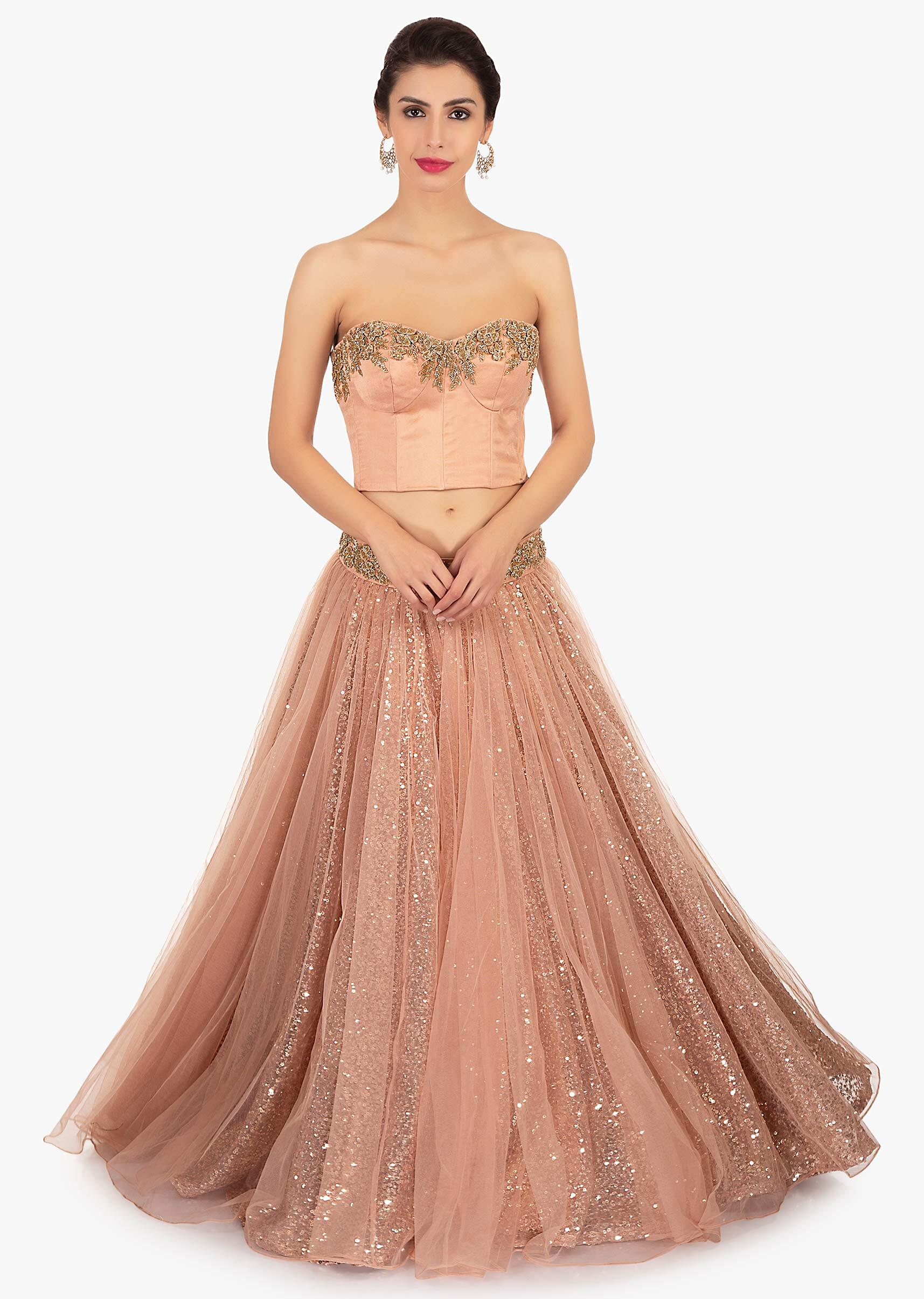 f27ec8f279 Dark peach strapless crop top paired with sequins fabric skirt only on Kalki