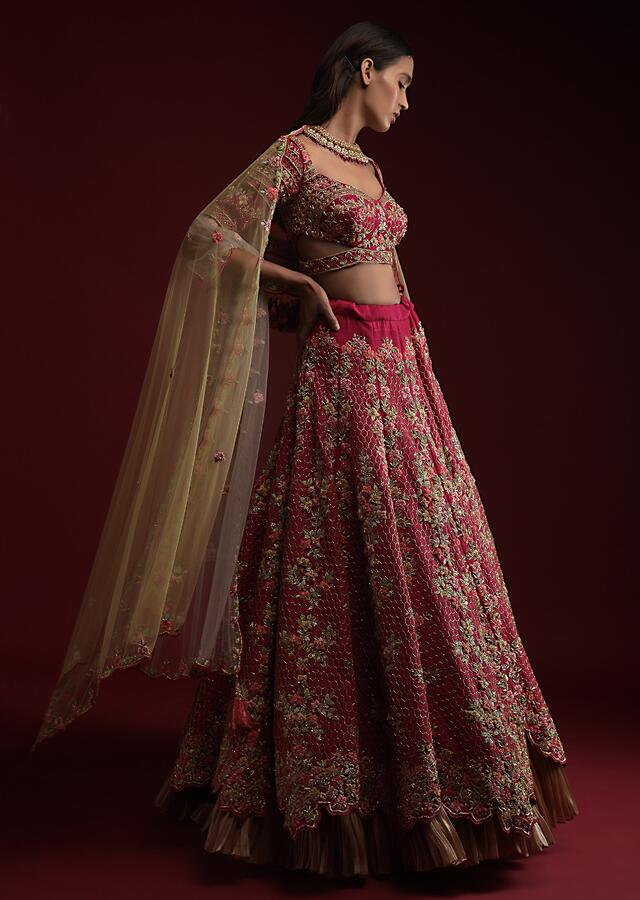 Dark Rani Pink Lehenga Choli In Raw Silk With Hand Embossed Embroidery Work In Floral And Honeycomb Motifs Online - Kalki Fashion