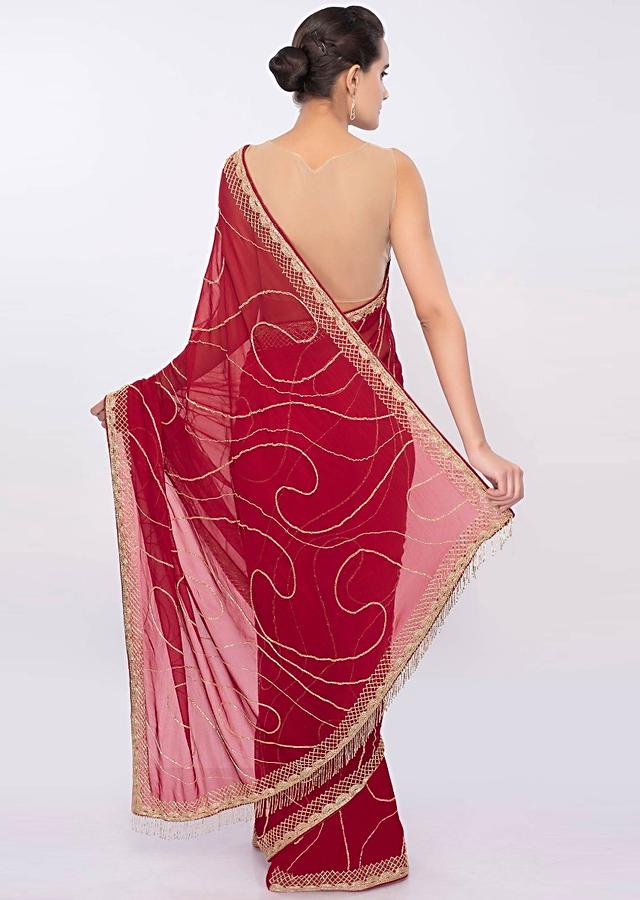 Dark red georgette saree in cut dana embroidery and butti only on Kalki