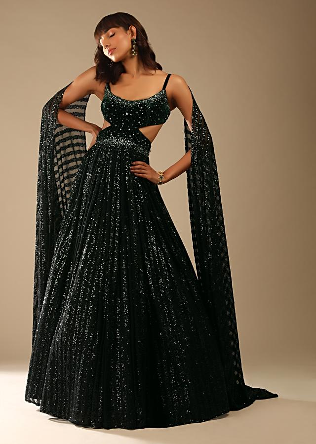 Dark Green Gown In Striped Sequins Fabric With A Velvet Bodice Adorned In Hand Embroidery And Cape On The Shoulder Online - Kalki Fashion