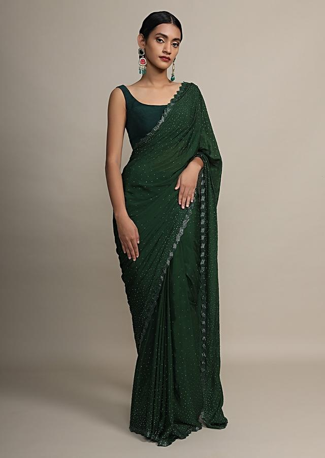 Dark green saree in satin chiffon with kundan and cut dana border only on Kalki