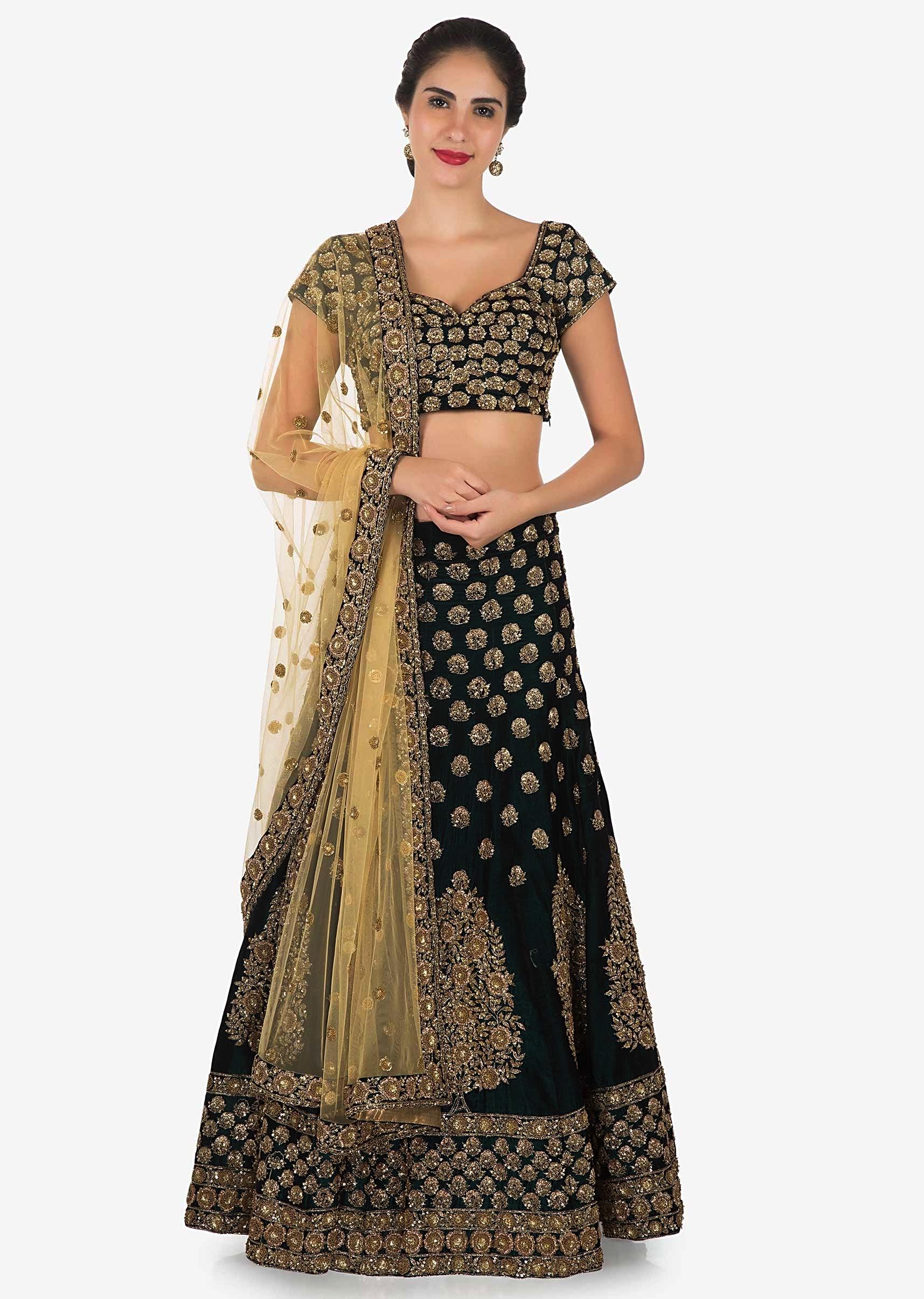 e6831557c5 Dark olive green embroidered lehenga matched with contrast beige dupatta  only on Kalki