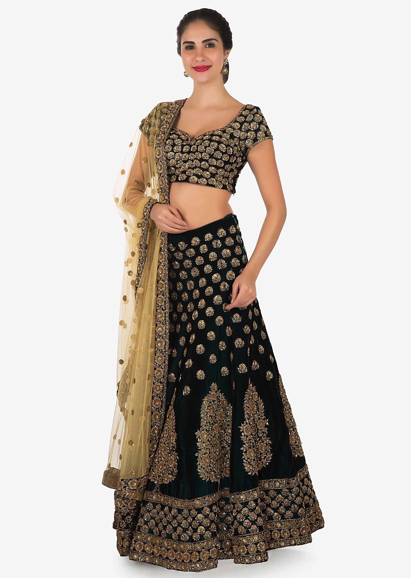 58ed44c179 Dark olive green embroidered lehenga matched with contrast beige dupatta  only on KalkiMore Detail