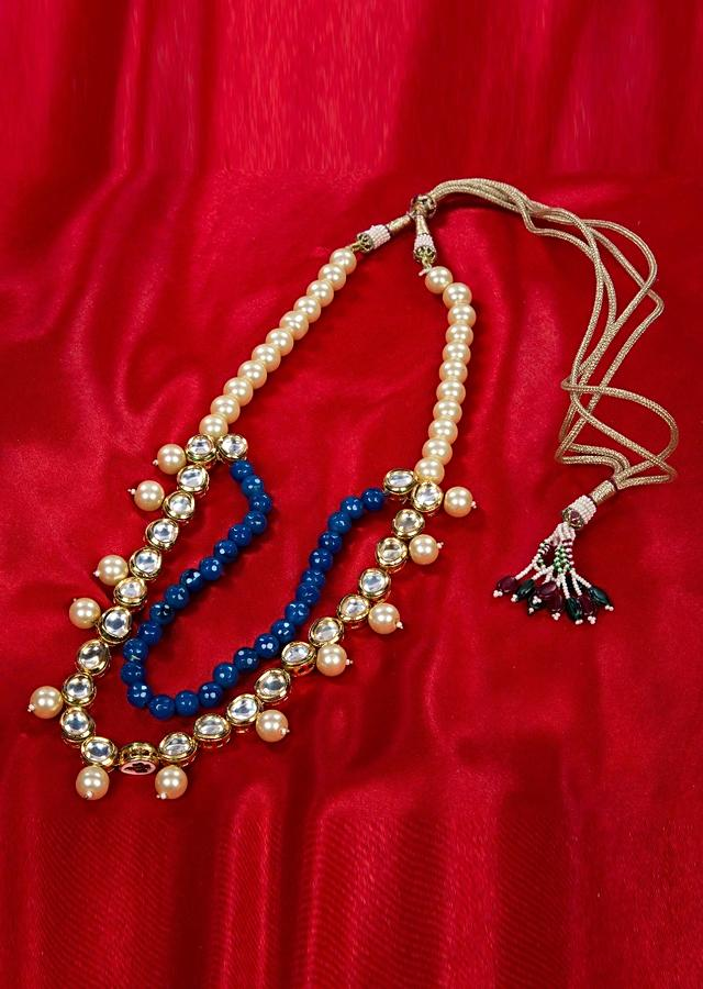 Double layer necklace adorn with cream pearls, kundan stone and round blue beads only on kalki
