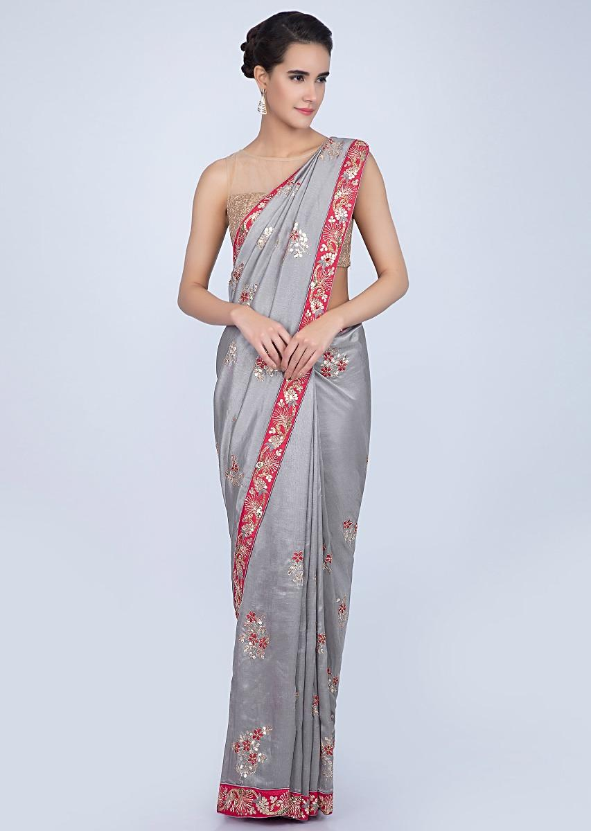 1b34fad5a30f4 Dove grey silk saree with floral embroidered butti and border only on Kalki