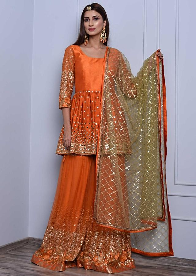 Orange sharara suit set in mirror and zari embroidery only on Kalki