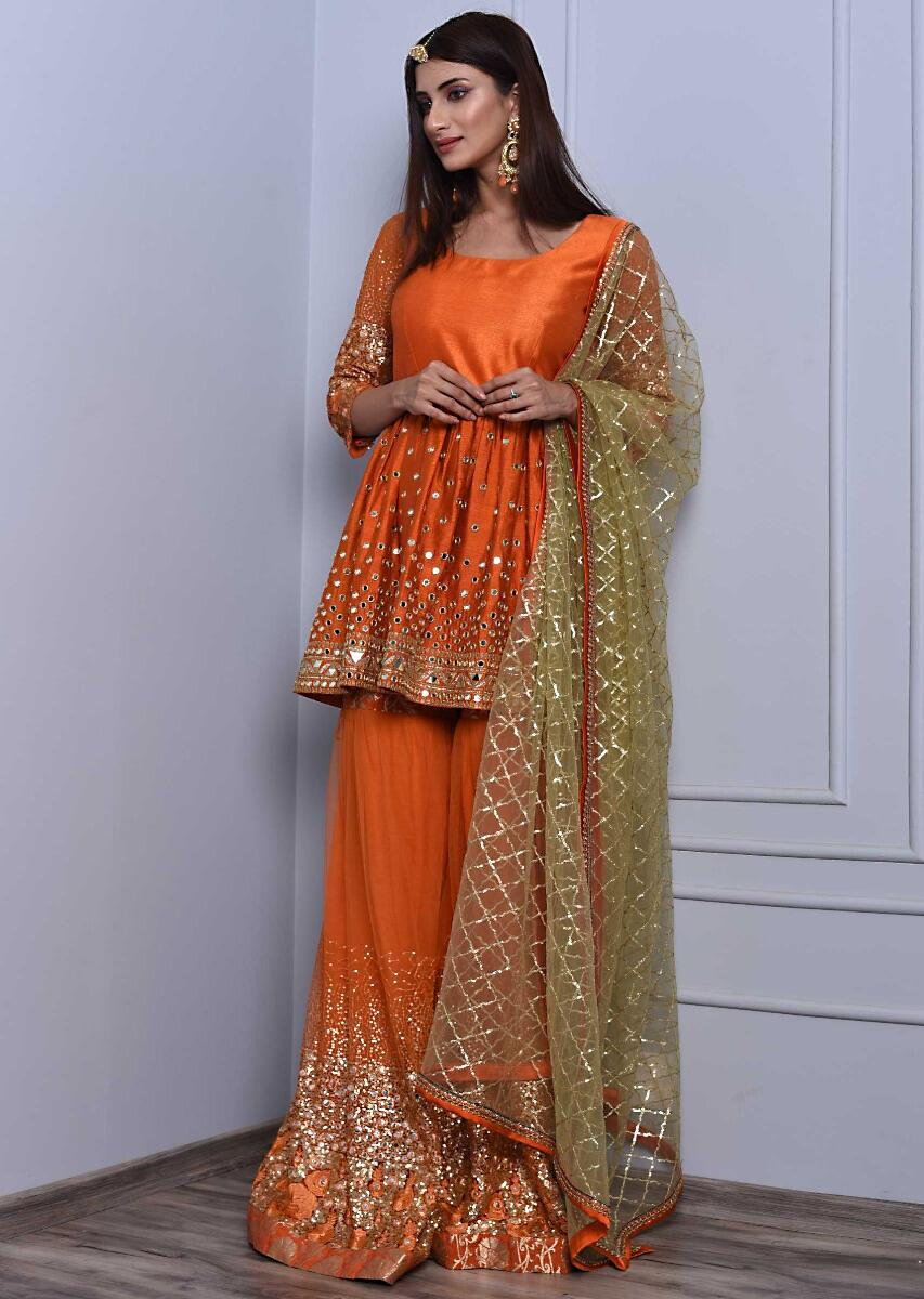 122ab4ae65 Orange sharara suit set in mirror and zari embroidery only on Kalki