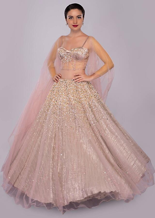 Neeti Mohan in Kalki dusty pink lehenga paired with multi paneled corset blouse  with attached net drape