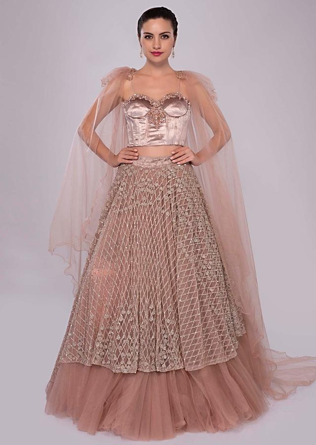 Dusty Pink Layered Skirt In Net With Paris Velvet Bustier Having Trail Attached At The Shoulder With Tassel Online - Kalki Fashion
