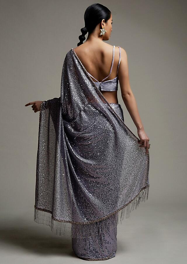 Dusty Purple Saree In Sequins Fabric With Fringes On The Pallu And Unstitched Blouse Online - Kalki Fashion