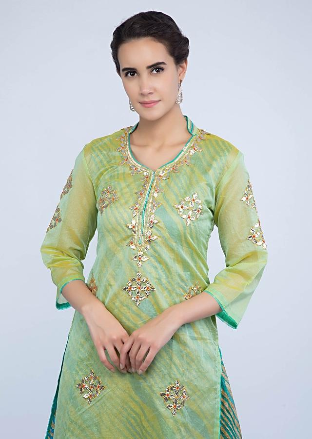 Embroidered green suit with under layer anarkali in multi color stripes only on Kalki