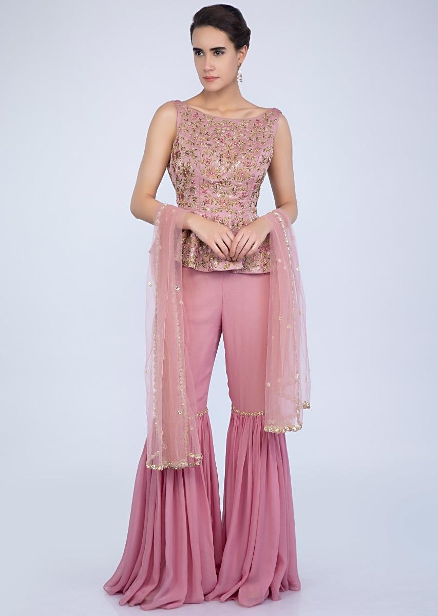 5982629e58 Embroidered pink peplum top with matching sharara and net dupatta only on  Kalki