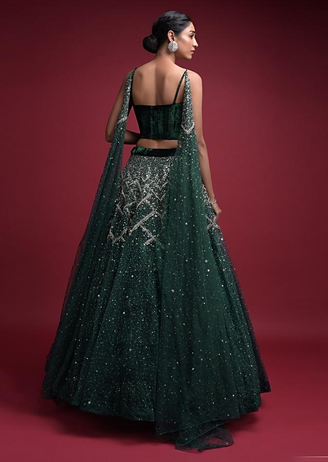 Emerald Green Lehenga In Hand Crafted Net And Velvet Crop Top With Attached Net Dupatta Online - Kalki Fashion