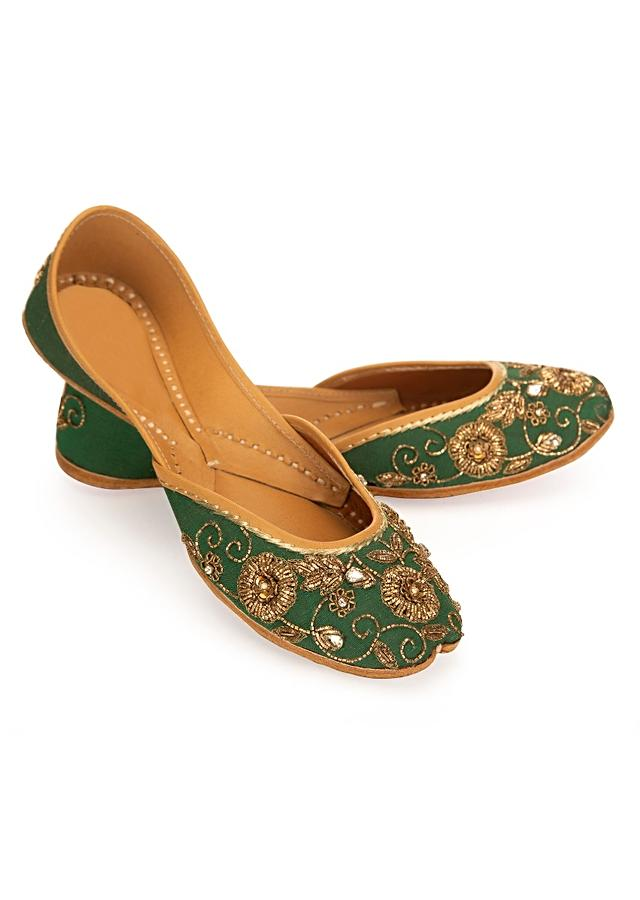 Emerald green pair of designer juttis embossed in floral motif