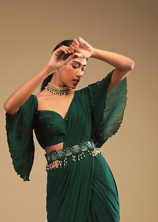 Emerald Green Ready Pleated Saree In Georgette With Bell Sleeves Crop Top And Chunky Embroidered Belt Online - Kalki Fashion