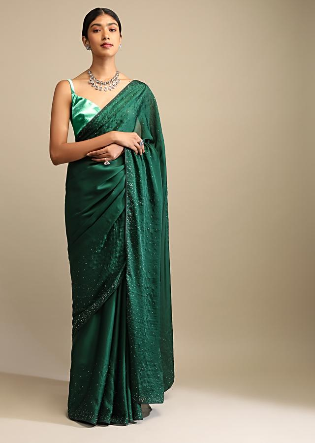 Emerald Green Saree In Satin Embellished With Scattered Red And Silver Kundan Along The Border And Unstitched Blouse Online - Kalki Fashion