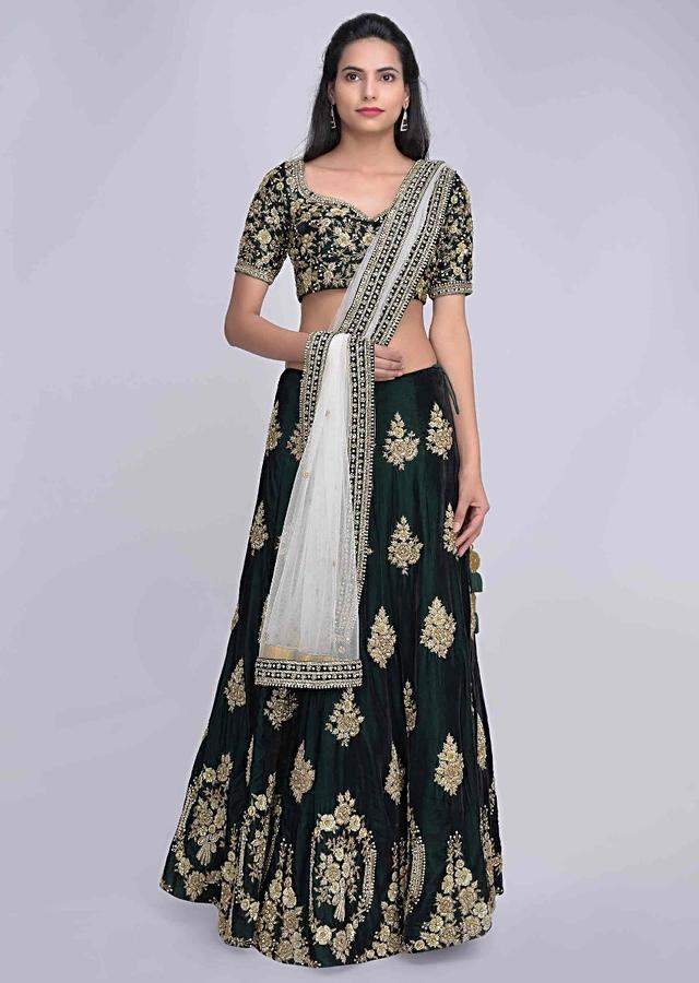 Emerald Green Lehenga Choli In Velvet With Powder White Net Dupatta Online - Kalki Fashion