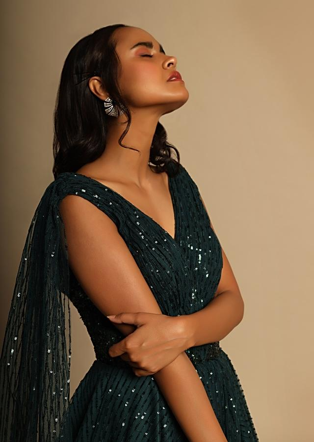 Emerald Green Gown In Net With Sequins Embellished Stripes And Attached Drape Online - Kalki Fashion