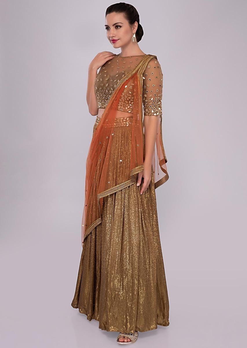 9fb466f0bd223 Fancy fabric lehenga paired with embroidered net blouse and contrasting  orange dupatta only on Kalki