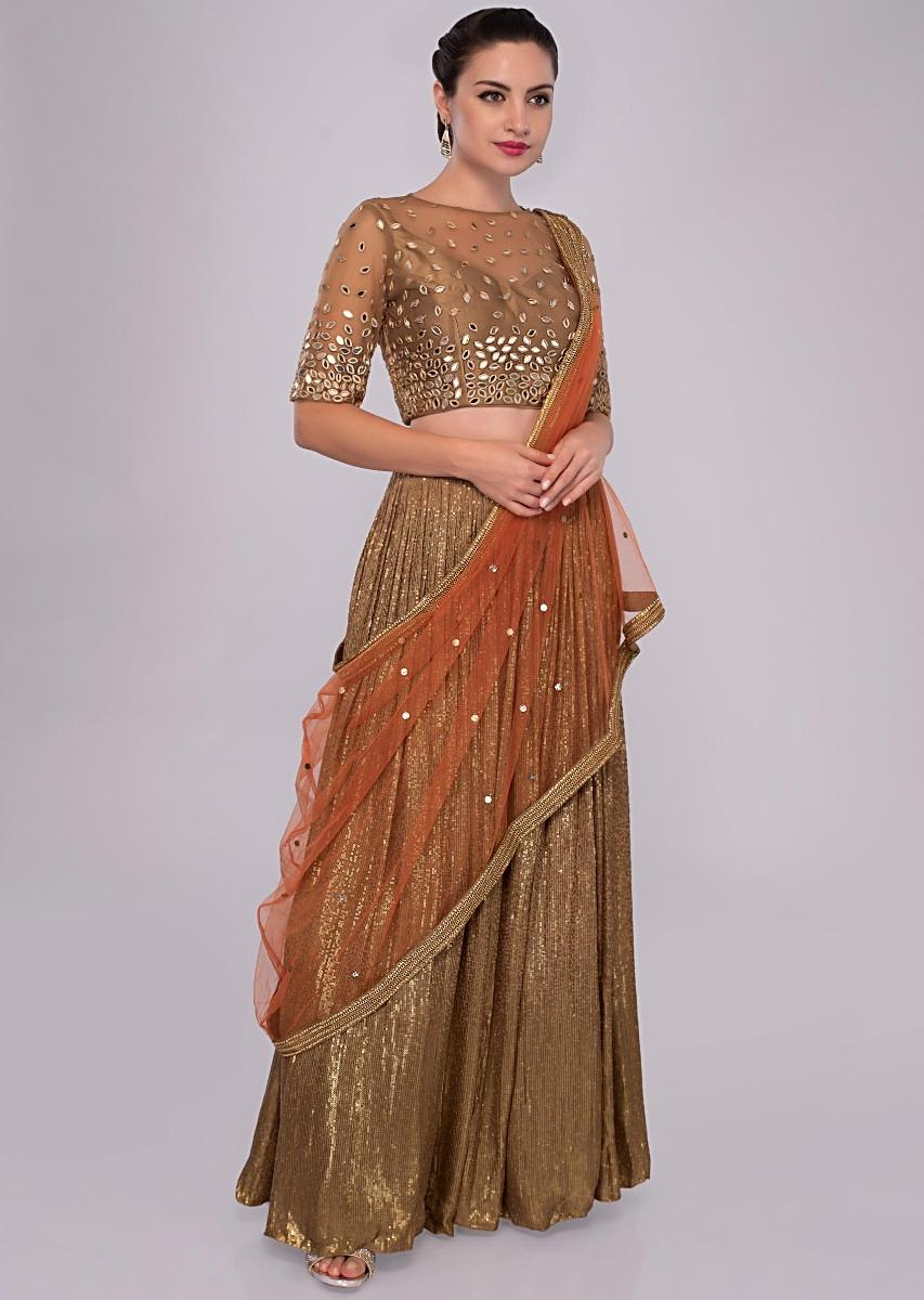 e00c575f6c300 Fancy fabric lehenga paired with embroidered net blouse and contrasting  orange dupatta only on KalkiMore Detail