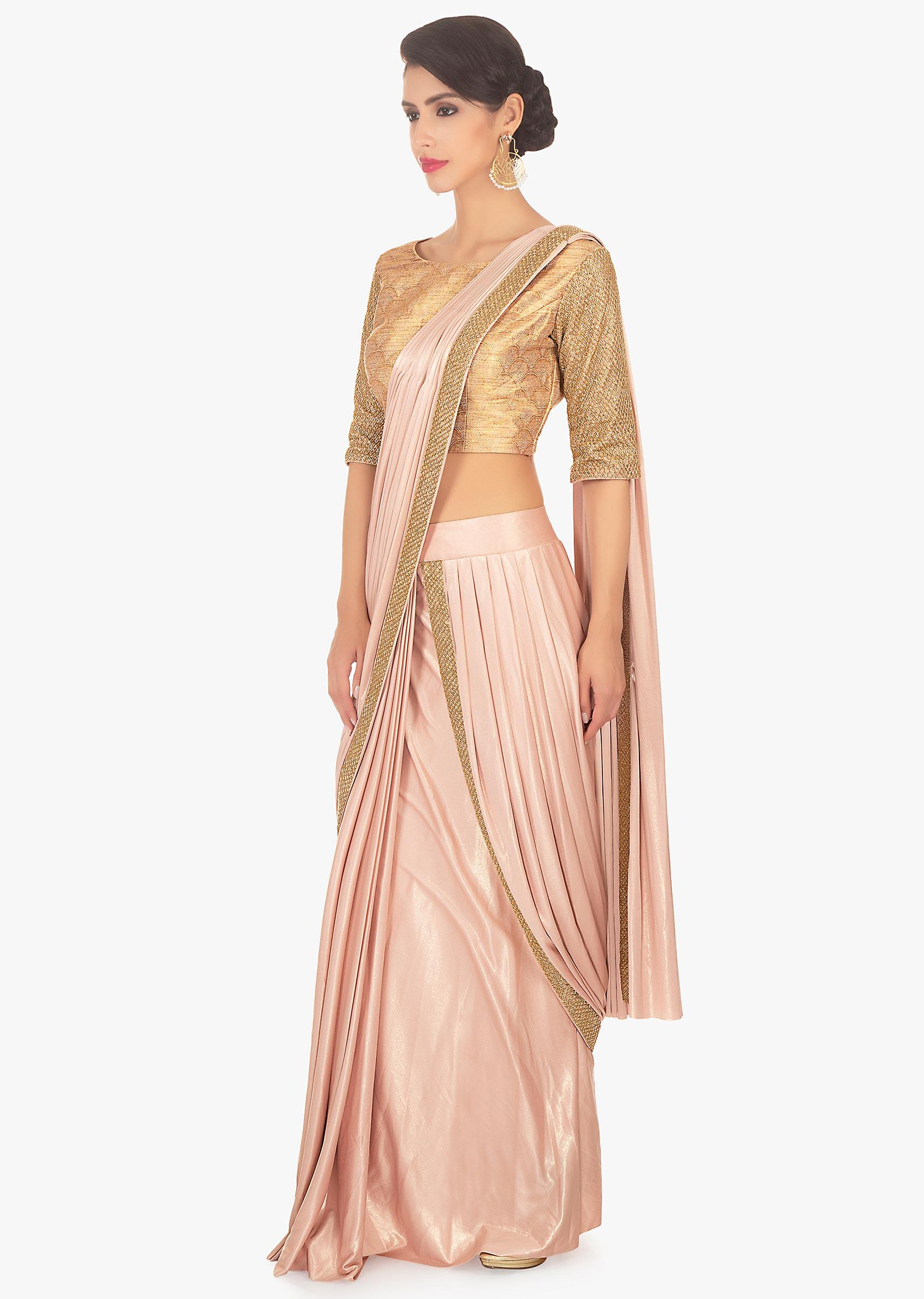 24498cbd8 Fancy fabric peach blouse with lycra saree skirt in ready plated pre  stitched pallo only on Kalki