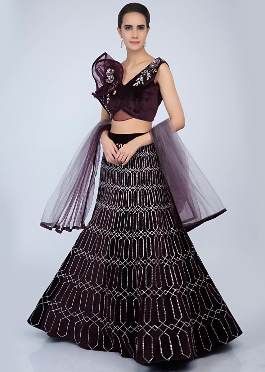 Fancy velvet blouse with ruffled panel sleeves paired with shaded plum  velvet lehenga only on Kalki fa774a511