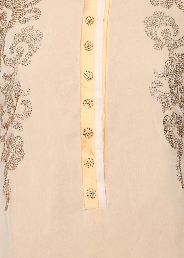Featuring a beige georgette straight cut semi stitched salwar kameez embellished in kundan only on Kalki