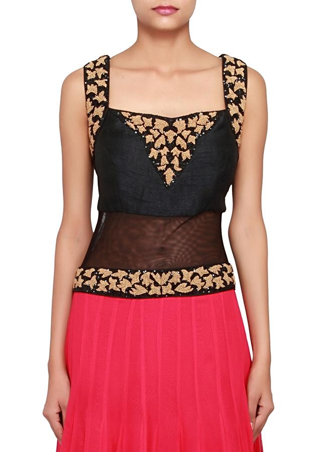Featuring a black and Fushia georgette anarkali embellished in french knot and sequence only on Kalki