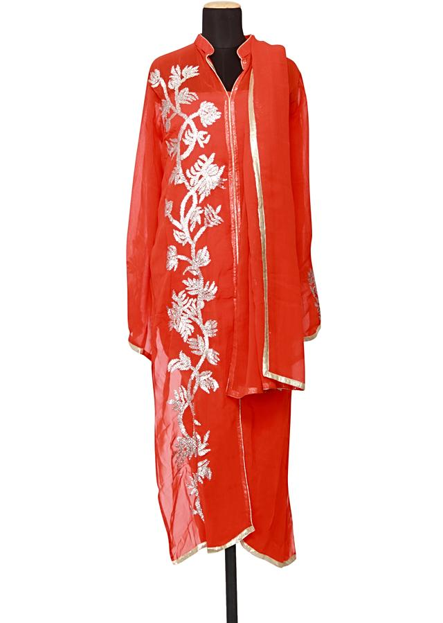 Featuring a coral georgette straight fit semi stitched salwar kameez embellished in gotta patti only on Kalki