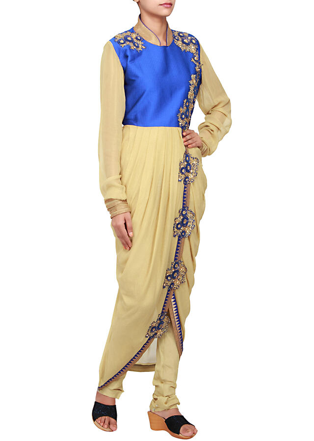 Featuring a gold shimmer suit embellished in patch embroidery only on Kalki