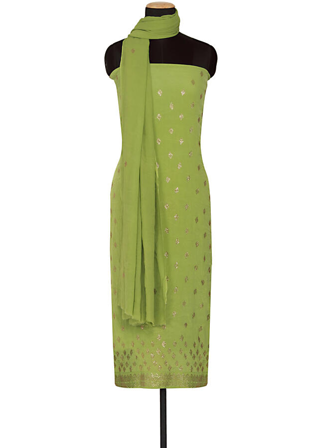 Featuring a green georgette unstitched salwar-kameez embellished in kundan only on Kalki