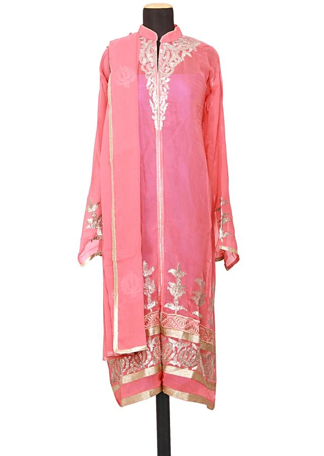Featuring a peach georgette straight fit semi stitched salwar kameez embellished in gotta patti only on Kalki