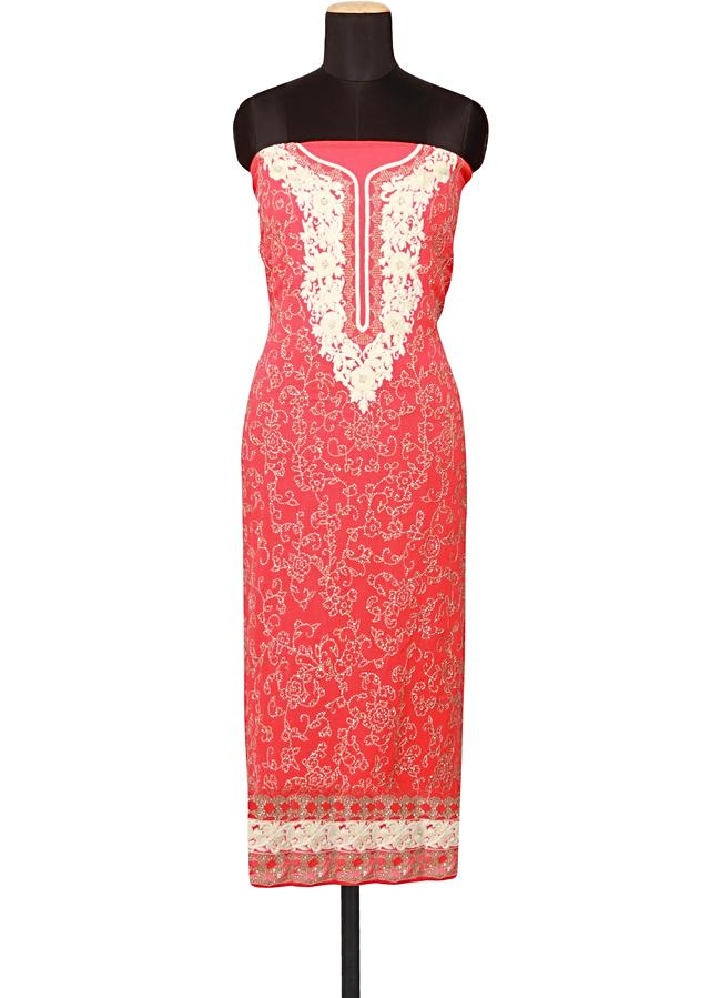 Featuring a peach unstitched salwar kameez embellished in sequin, kundanand thread only on Kalki