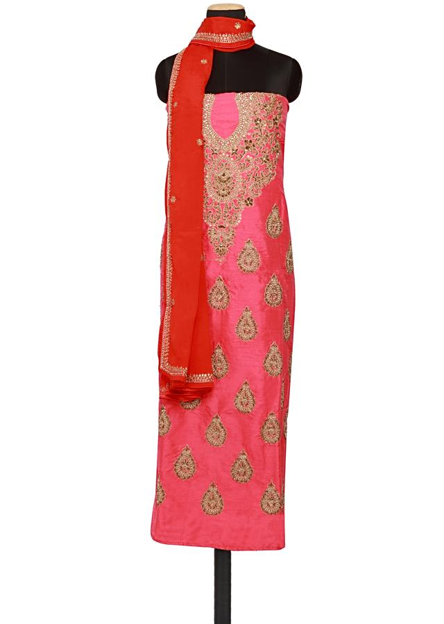 Featuring a pink georgette unstitched salwar kameez embellished in gold zari embroidery only on Kalki