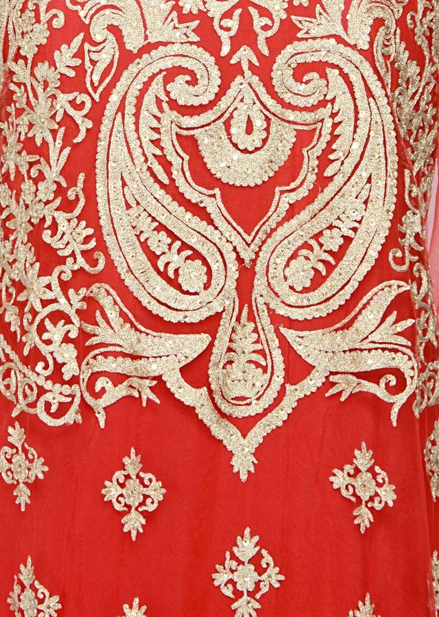 Featuring a red net straight fit semi stitched salwar kameez embellished in zari, kundan and sequin only on Kalki