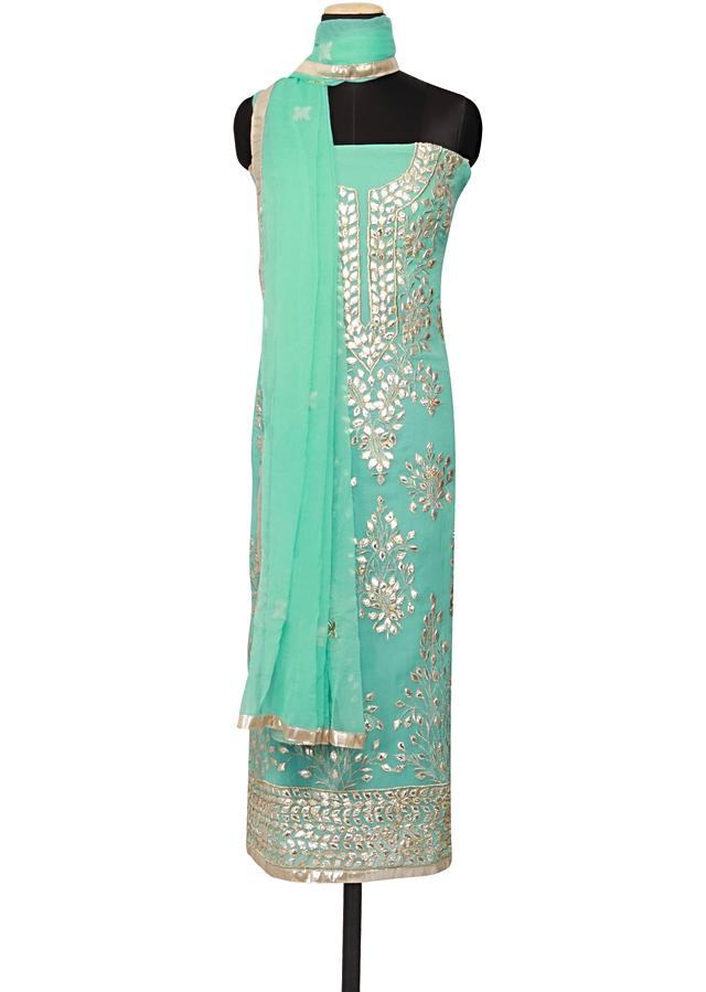 Featuring a turquoise georgette unstitched salwar kameez embellished in gotta patti only on Kalki