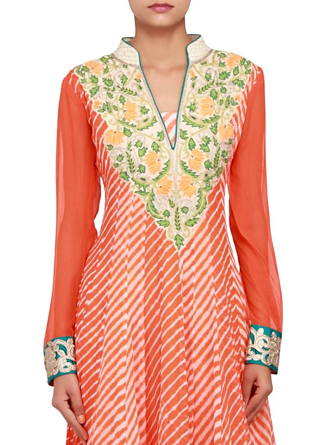 Featuring an orange leheriya print georgette anarkali embellished in patch work only on Kalki