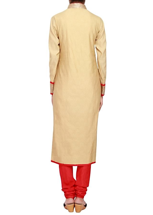 Featuring beige cotton straight fit suit embellished in kardana work only on Kalki