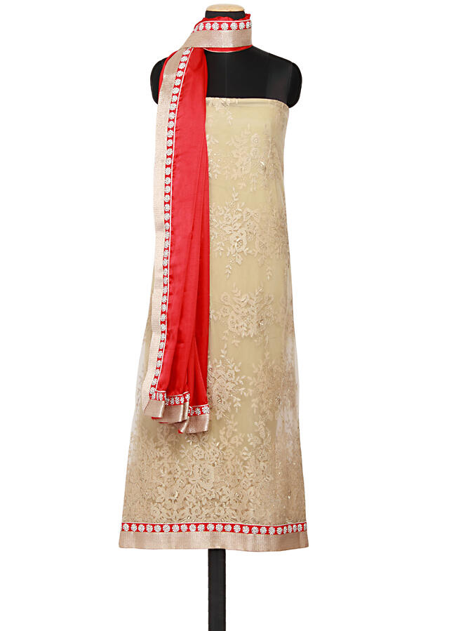 Featuring gold chantling net unstitched salwar kameez embellished in gold zari and stone work only on Kalki