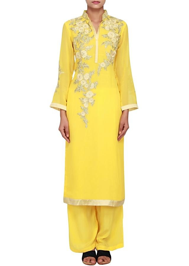 Featuring yellow georgette straight cut suit embellished in zari only on Kalki