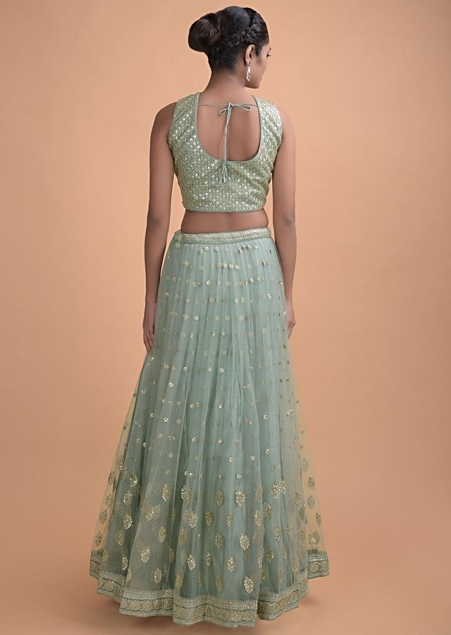 Fern Green Lehenga In Net With Embellished Sequins And Zari Buttis In Floral And Leaf Motifs Online - Kalki Fashion