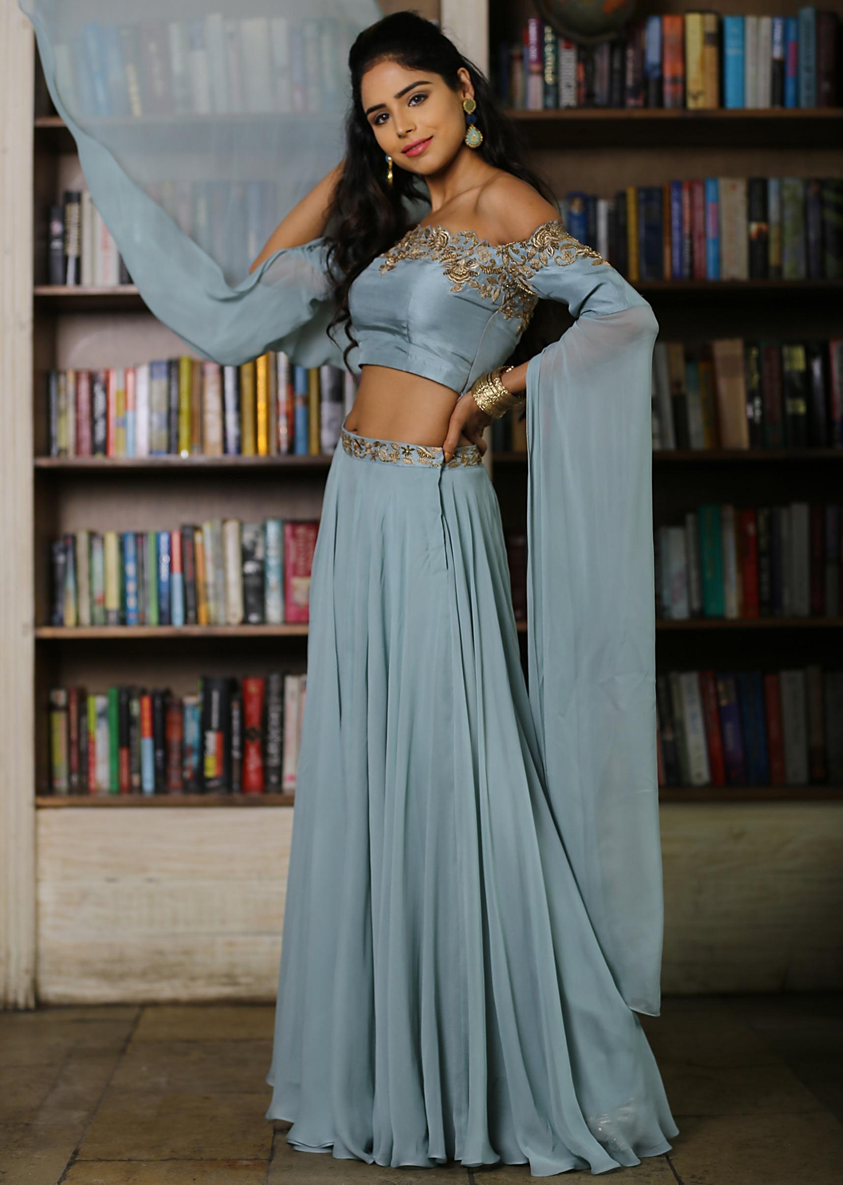 adb9222499 Fern green skirt paired with paired with off shoulder crop top with cape  sleeves only on Kalki