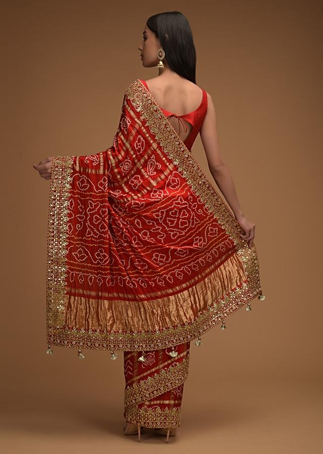 Fiery Red Saree With Bandhani Print And Gotta Patti Work Paired With Unstitched Blouse Online - Kalki Fashion