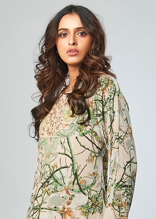 Floral printed suit with cream beige under layer and flared palazzo only on Kalki