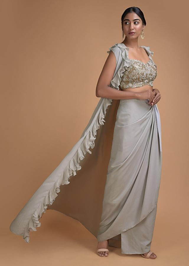 Fog Grey Crop Top And Skirt With A Matching Sleeveless Jacket With Ruffles Online - Kalki Fashion